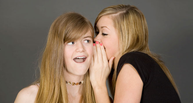 Teen-girl-sharing-a-secret