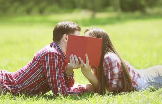 couple-kissing-behind-book